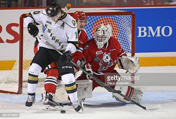 Christian Dvorak of the London Knights looks to deflect a shot past Alex Nedeljkovic of the Niagara IceDogs during Game Four of the OHL Championship...