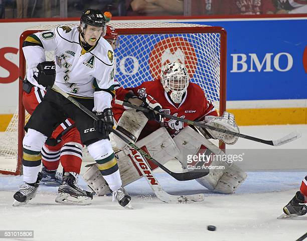 Christian Dvorak of the London Knights looks to tip an incoming shot past Alex Nedeljkovic of the Niagara IceDogs during Game Four of the OHL...