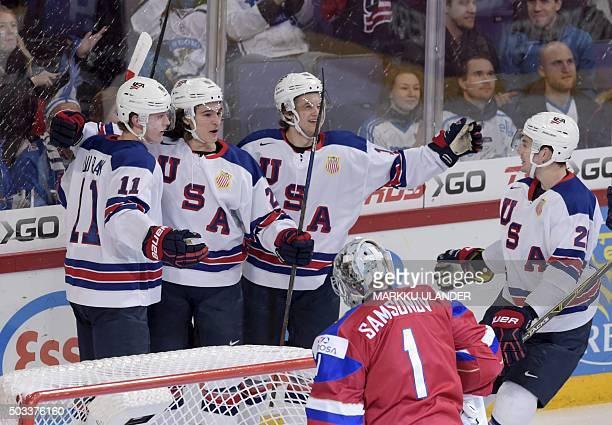 Christian Dvorak Sonny Milano Anders Bjork and Will Borgen of USA celebrate the 10 goal by Dvorak during the 2016 IIHF World Junior Ice Hockey...