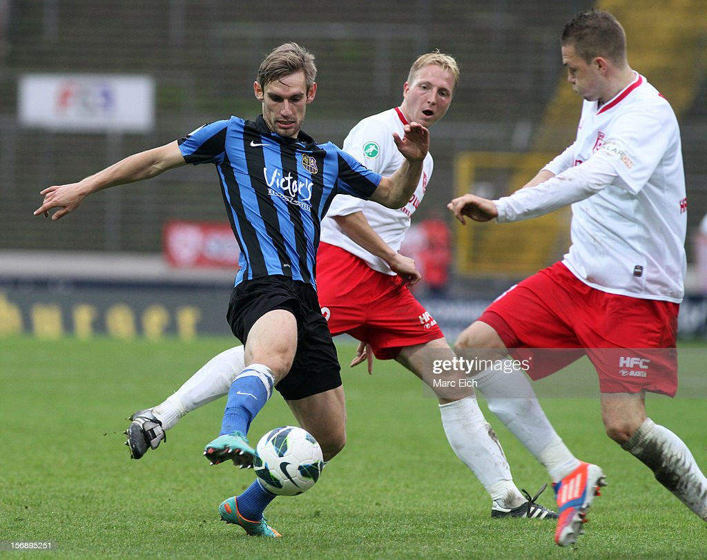 Christian Eggert of Saarbruecken (L) is challenged by Steven Ruprecht of Halle (R) during the Third League match between 1. FC Saarbruecken and Hallescher FC at Ludwigsparkstadion on November 24, 2012 in Saarbruecken, Germany.