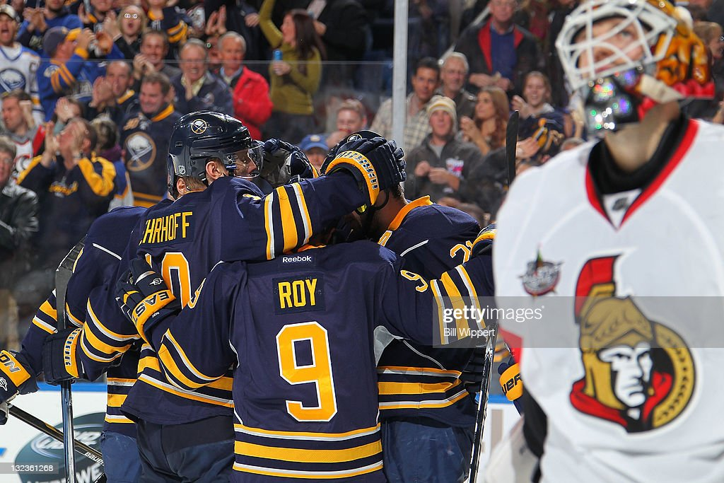 Christian Ehrhoff #10, <a gi-track='captionPersonalityLinkClicked' href=/galleries/search?phrase=Derek+Roy&family=editorial&specificpeople=203272 ng-click='$event.stopPropagation()'>Derek Roy</a> #9 and Drew Stafford #21 of the Buffalo Sabres celebrate a third period goal scored by Ville Leino (not shown) as goaltender <a gi-track='captionPersonalityLinkClicked' href=/galleries/search?phrase=Alex+Auld&family=editorial&specificpeople=217975 ng-click='$event.stopPropagation()'>Alex Auld</a> #35 of the Ottawa Senators looks upward at First Niagara Center on November 11, 2011 in Buffalo, New York.