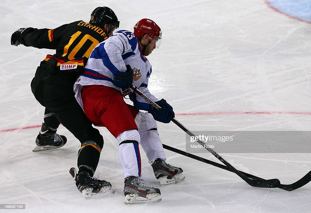 Christian Ehrhoff (L) of Germany and Denis Kokarev (R) of Russia battle for positoin in front of the net during the IIHF World Championship group H match between Germany and Russia at Hartwall Areena on May 5, 2013 in Helsinki, Finland.