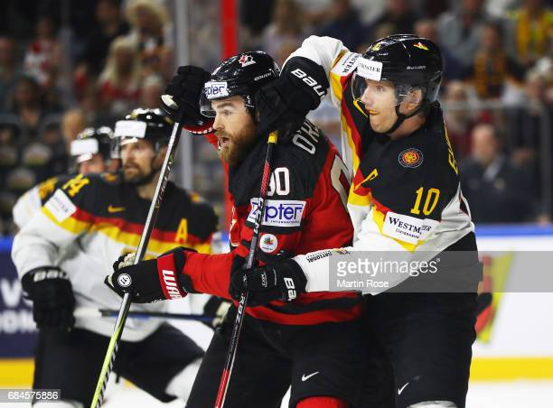Christian Ehrhoff of Germany challenges Ryan O'Reilly of Canada during the 2017 IIHF Ice Hockey World Championship Quarter Final game between Canada...