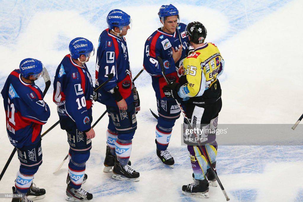 <a gi-track='captionPersonalityLinkClicked' href=/galleries/search?phrase=Christian+Ehrhoff&family=editorial&specificpeople=214788 ng-click='$event.stopPropagation()'>Christian Ehrhoff</a> (R) of Krefeld chats with <a gi-track='captionPersonalityLinkClicked' href=/galleries/search?phrase=Marcel+Goc&family=editorial&specificpeople=541626 ng-click='$event.stopPropagation()'>Marcel Goc</a> of Mannheim after the DEL match between Adler Mannheim and Krefeld Pinguine at SAP-Arena on October 12, 2012 in Mannheim, Germany.