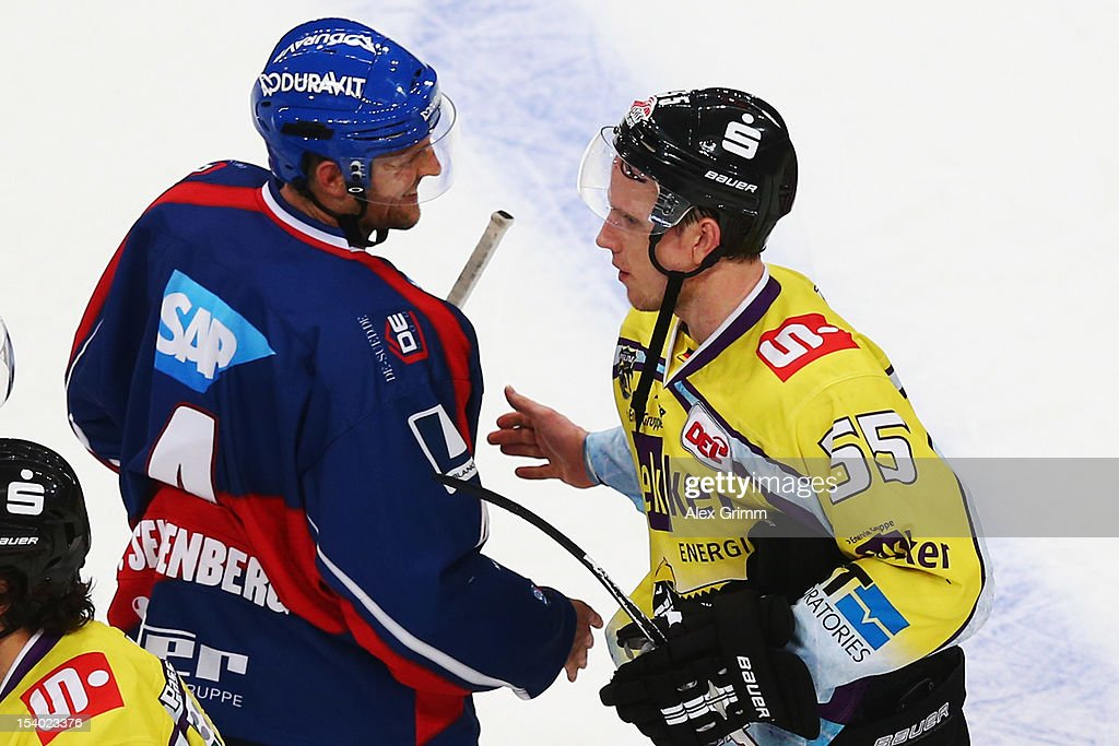 Christian Ehrhoff (R) of Krefeld shakes hands with Dennis Seidenberg of Mannheim after the DEL match between Adler Mannheim and Krefeld Pinguine at SAP-Arena on October 12, 2012 in Mannheim, Germany.