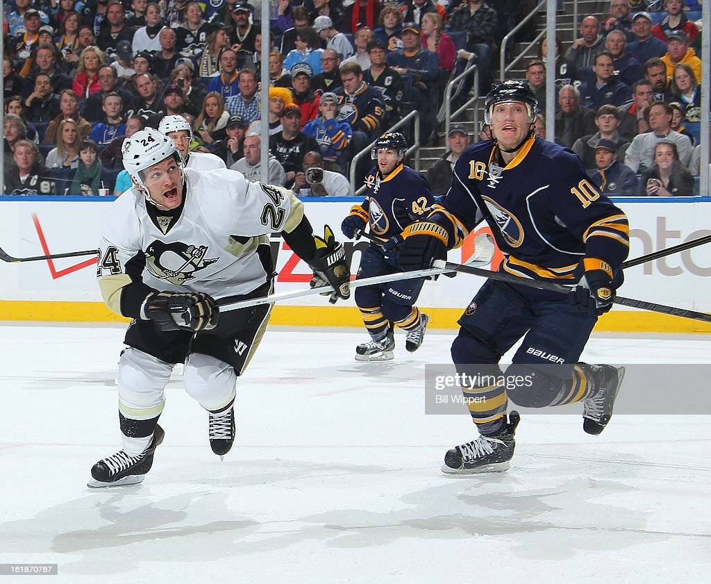 Christian Ehrhoff #10 of the Buffalo Sabres and Matt Cooke #24 of the Pittsburgh Penguins look for a loose puck during the play of the second period on February 17, 2013 at the First Niagara Center in Buffalo, New York.