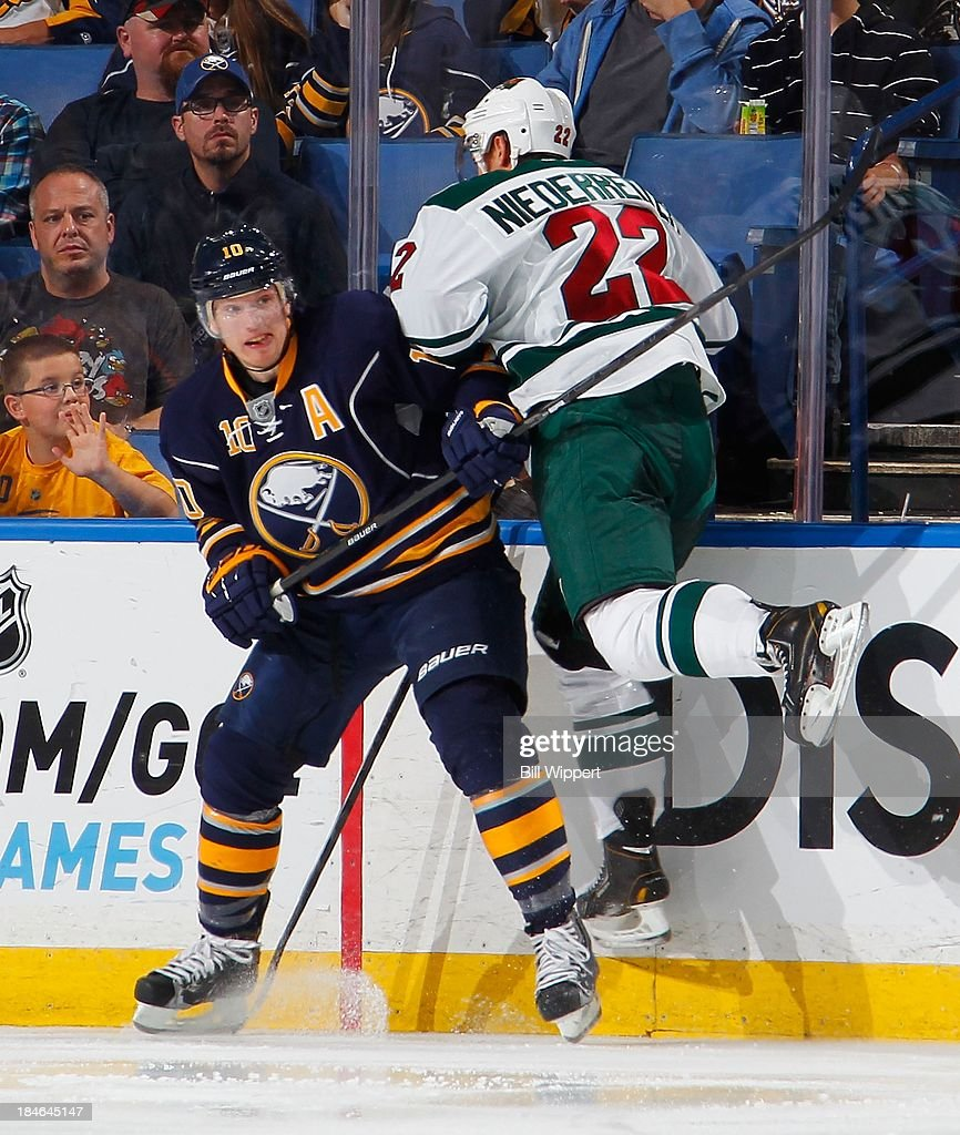 <a gi-track='captionPersonalityLinkClicked' href=/galleries/search?phrase=Christian+Ehrhoff&family=editorial&specificpeople=214788 ng-click='$event.stopPropagation()'>Christian Ehrhoff</a> #10 of the Buffalo Sabres avoids a check from <a gi-track='captionPersonalityLinkClicked' href=/galleries/search?phrase=Nino+Niederreiter&family=editorial&specificpeople=6667732 ng-click='$event.stopPropagation()'>Nino Niederreiter</a> #22 of the Minnesota Wild on October 14, 2013 at the First Niagara Center in Buffalo, New York. Minnesota won, 2-1.
