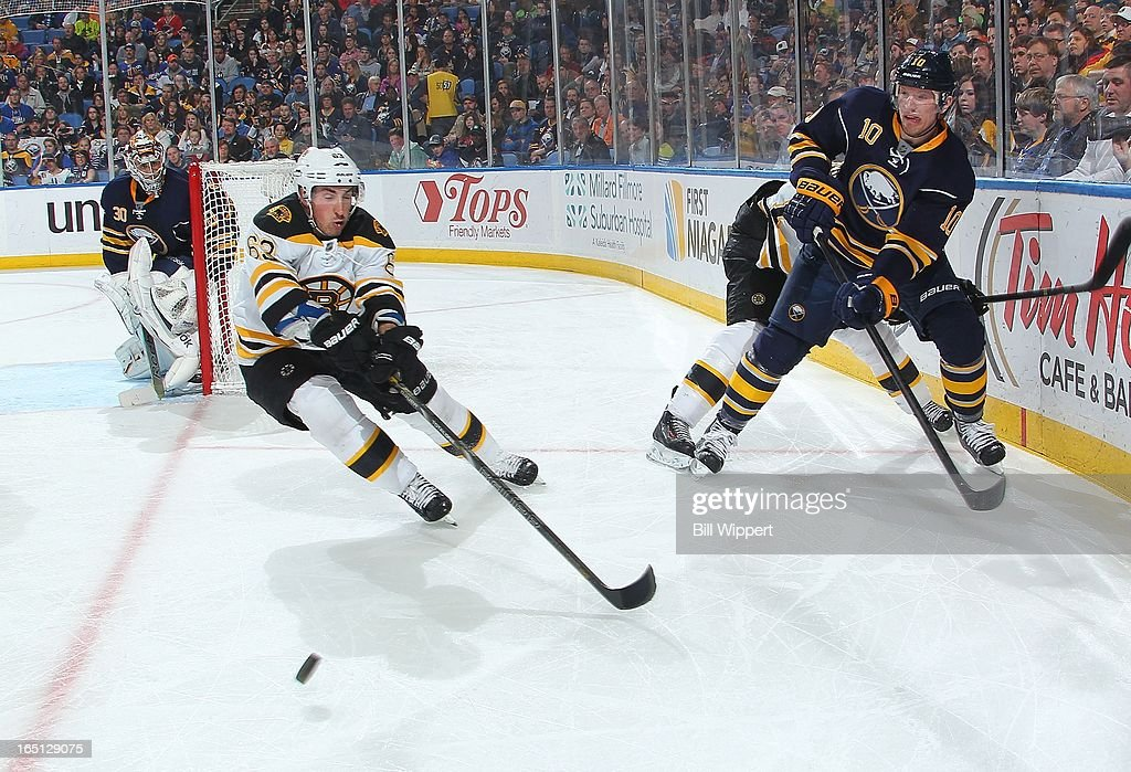 <a gi-track='captionPersonalityLinkClicked' href=/galleries/search?phrase=Christian+Ehrhoff&family=editorial&specificpeople=214788 ng-click='$event.stopPropagation()'>Christian Ehrhoff</a> #10 of the Buffalo Sabres battles for the puck against <a gi-track='captionPersonalityLinkClicked' href=/galleries/search?phrase=Brad+Marchand&family=editorial&specificpeople=2282544 ng-click='$event.stopPropagation()'>Brad Marchand</a> #63 of the Boston Bruins on March 31, 2013 at the First Niagara Center in Buffalo, New York.