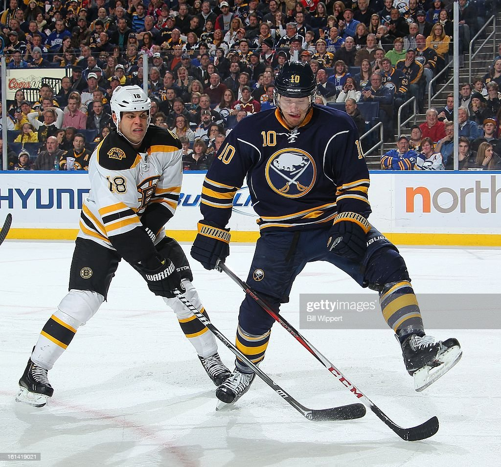 <a gi-track='captionPersonalityLinkClicked' href=/galleries/search?phrase=Christian+Ehrhoff&family=editorial&specificpeople=214788 ng-click='$event.stopPropagation()'>Christian Ehrhoff</a> #10 of the Buffalo Sabres battles for the puck with <a gi-track='captionPersonalityLinkClicked' href=/galleries/search?phrase=Nathan+Horton&family=editorial&specificpeople=204741 ng-click='$event.stopPropagation()'>Nathan Horton</a> #18 of the Boston Bruins on February 10, 2013 at the First Niagara Center in Buffalo, New York. Boston defeated Buffalo, 3-1.