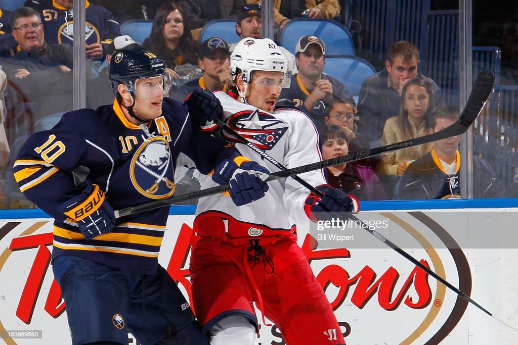 <a gi-track='captionPersonalityLinkClicked' href=/galleries/search?phrase=Christian+Ehrhoff&family=editorial&specificpeople=214788 ng-click='$event.stopPropagation()'>Christian Ehrhoff</a> #10 of the Buffalo Sabres battles in front of the net with <a gi-track='captionPersonalityLinkClicked' href=/galleries/search?phrase=Artem+Anisimov&family=editorial&specificpeople=543215 ng-click='$event.stopPropagation()'>Artem Anisimov</a> #42 of the Columbus Blue Jackets on October 10, 2013 at the First Niagara Center in Buffalo, New York.