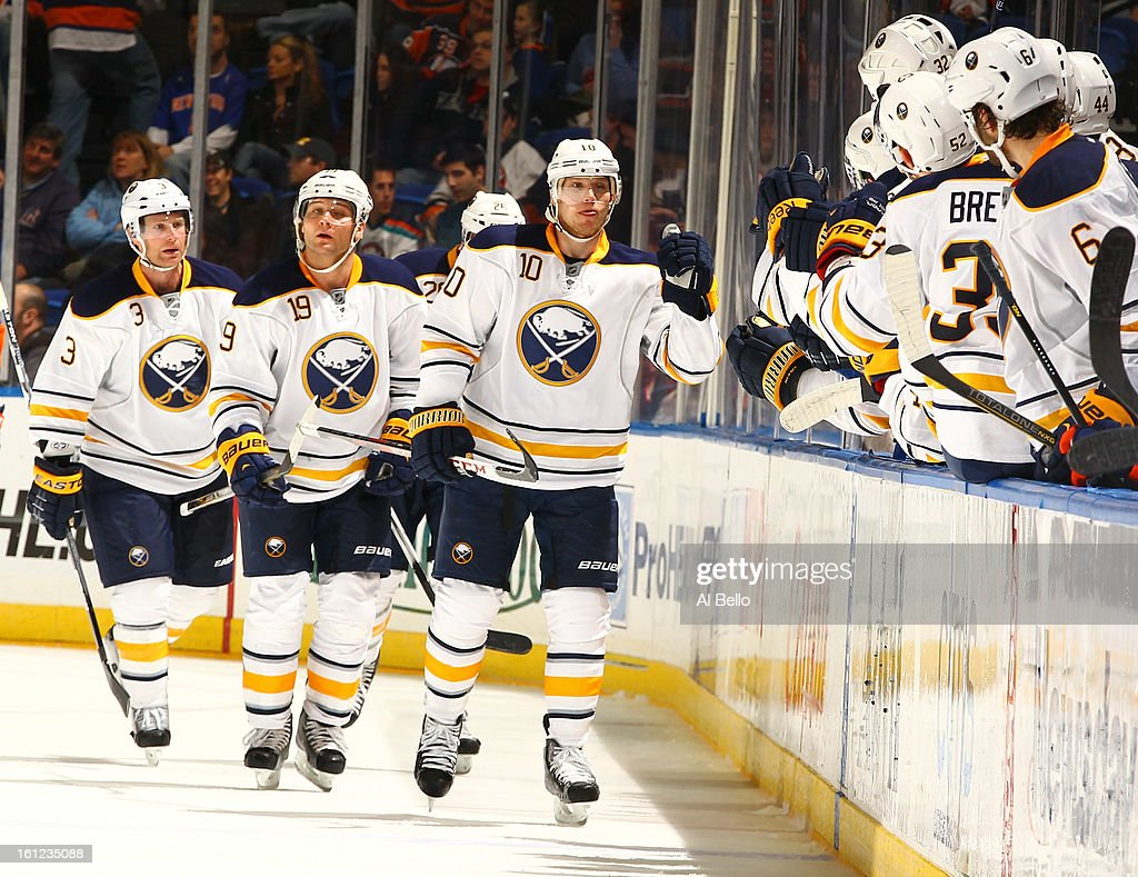 Christian Ehrhoff #10 of the Buffalo Sabres celebrates after scoring a goal against the New York Islanders during their game at Nassau Veterans Memorial Coliseum on February 9, 2013 in Uniondale, New York.