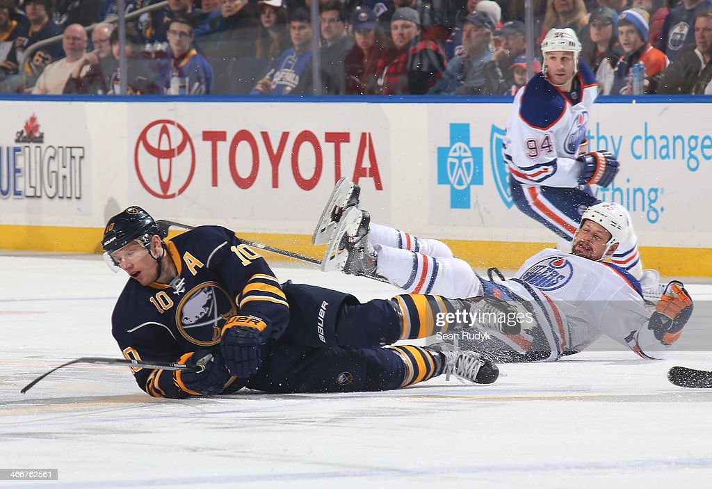 <a gi-track='captionPersonalityLinkClicked' href=/galleries/search?phrase=Christian+Ehrhoff&family=editorial&specificpeople=214788 ng-click='$event.stopPropagation()'>Christian Ehrhoff</a> #10 of the Buffalo Sabres collides with <a gi-track='captionPersonalityLinkClicked' href=/galleries/search?phrase=Matt+Hendricks&family=editorial&specificpeople=4537275 ng-click='$event.stopPropagation()'>Matt Hendricks</a> #23 of the Edmonton Oilers during the first period at First Niagara Center on February 3, 2014 in Buffalo, New York. The Edmonton Oilers defeated the Buffalo Sabres 3-2.