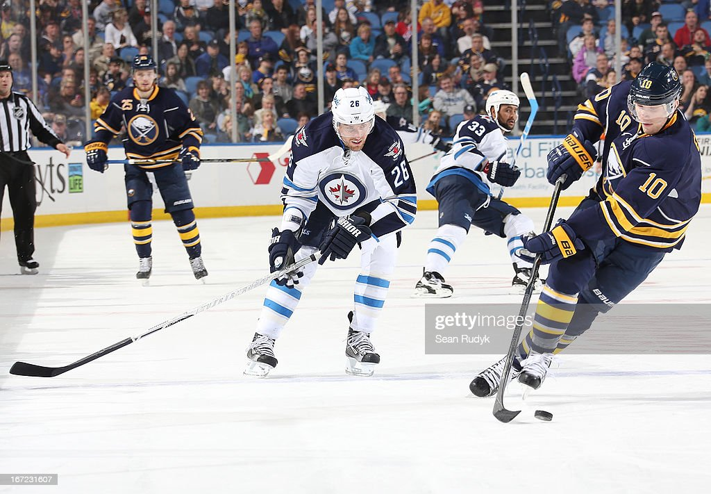 <a gi-track='captionPersonalityLinkClicked' href=/galleries/search?phrase=Christian+Ehrhoff&family=editorial&specificpeople=214788 ng-click='$event.stopPropagation()'>Christian Ehrhoff</a> #10 of the Buffalo Sabres controls the puck against <a gi-track='captionPersonalityLinkClicked' href=/galleries/search?phrase=Blake+Wheeler&family=editorial&specificpeople=716703 ng-click='$event.stopPropagation()'>Blake Wheeler</a> #26 of the Winnipeg Jets at First Niagara Center on April 22, 2013 in Buffalo, New York. Winnipeg defeated Buffalo, 2-1.