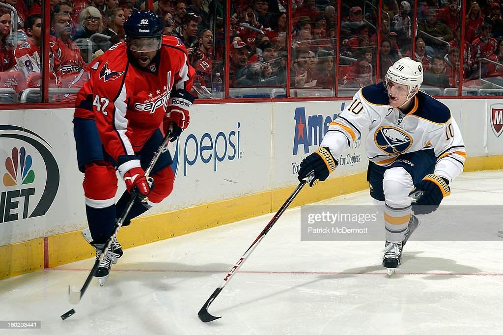 <a gi-track='captionPersonalityLinkClicked' href=/galleries/search?phrase=Christian+Ehrhoff&family=editorial&specificpeople=214788 ng-click='$event.stopPropagation()'>Christian Ehrhoff</a> #10 of the Buffalo Sabres defends as Joel Ward #42 of the Washington Capitals brings the puck around the net during the second period of an NHL hockey game at Verizon Center on January 27, 2013 in Washington, DC.