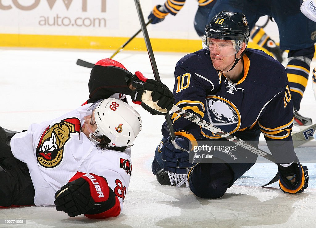 <a gi-track='captionPersonalityLinkClicked' href=/galleries/search?phrase=Christian+Ehrhoff&family=editorial&specificpeople=214788 ng-click='$event.stopPropagation()'>Christian Ehrhoff</a> #10 of the Buffalo Sabres gets tied up with <a gi-track='captionPersonalityLinkClicked' href=/galleries/search?phrase=Cory+Conacher&family=editorial&specificpeople=8312407 ng-click='$event.stopPropagation()'>Cory Conacher</a> #89 of the Ottawa Senators after falling to the ice on April 05, 2013 at the First Niagara Center in Buffalo, New York.