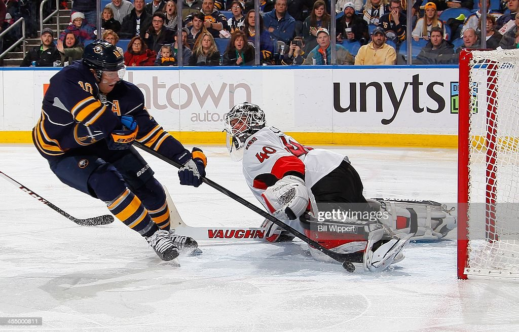 Christian Ehrhoff #10 of the Buffalo Sabres is stopped on a third period breakaway by Robin Lehner #40 of the Ottawa Senators on December 10, 2013 at the First Niagara Center in Buffalo, New York. Buffalo won, 2-1.