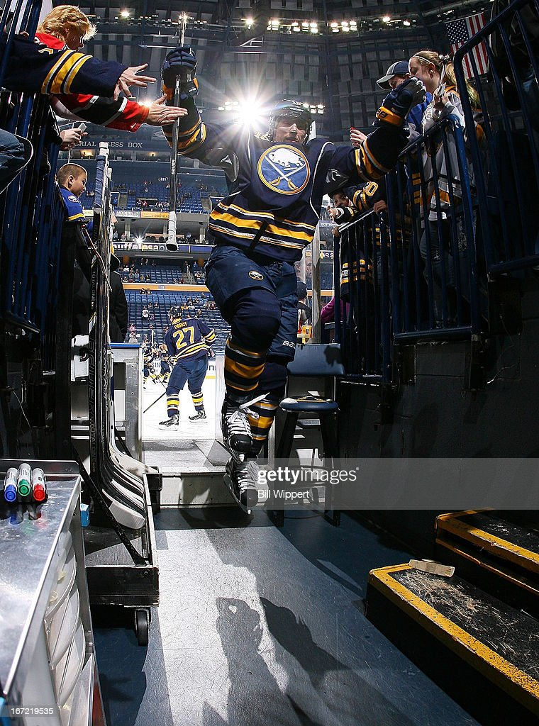 Christian Ehrhoff #10 of the Buffalo Sabres leaps through the air as he leaves the ice after warming up to play the Winnipeg Jets on April 22, 2013 at the First Niagara Center in Buffalo, New York.