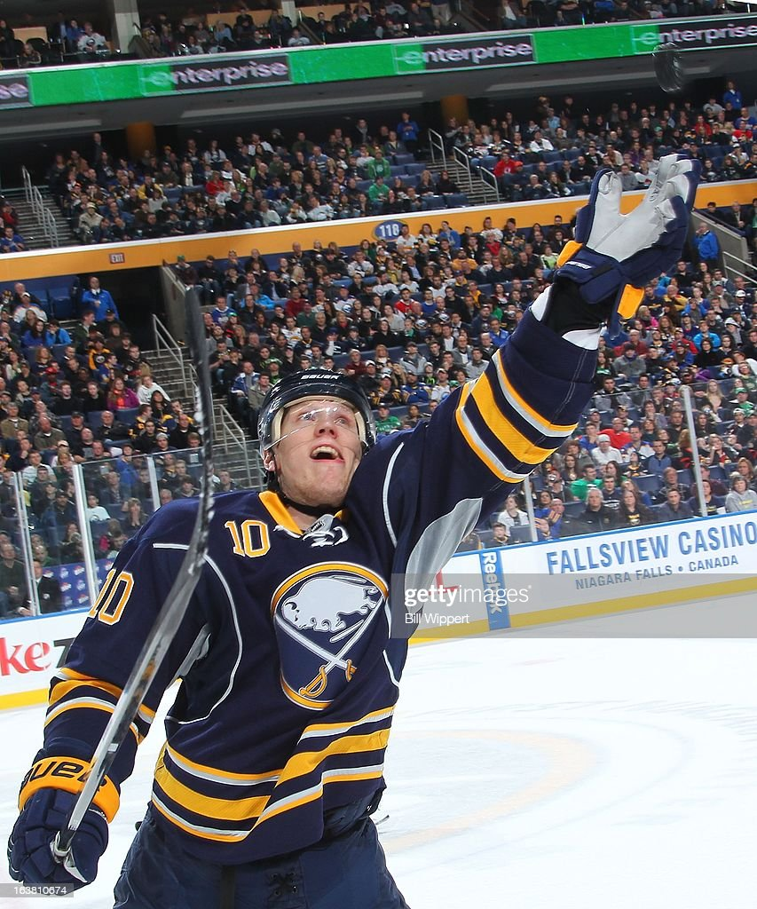 <a gi-track='captionPersonalityLinkClicked' href=/galleries/search?phrase=Christian+Ehrhoff&family=editorial&specificpeople=214788 ng-click='$event.stopPropagation()'>Christian Ehrhoff</a> #10 of the Buffalo Sabres reaches to catch a flying puck in their game against the Ottawa Senators on March 16, 2013 at the First Niagara Center in Buffalo, New York. Ottawa defeated Buffalo, 4-3.
