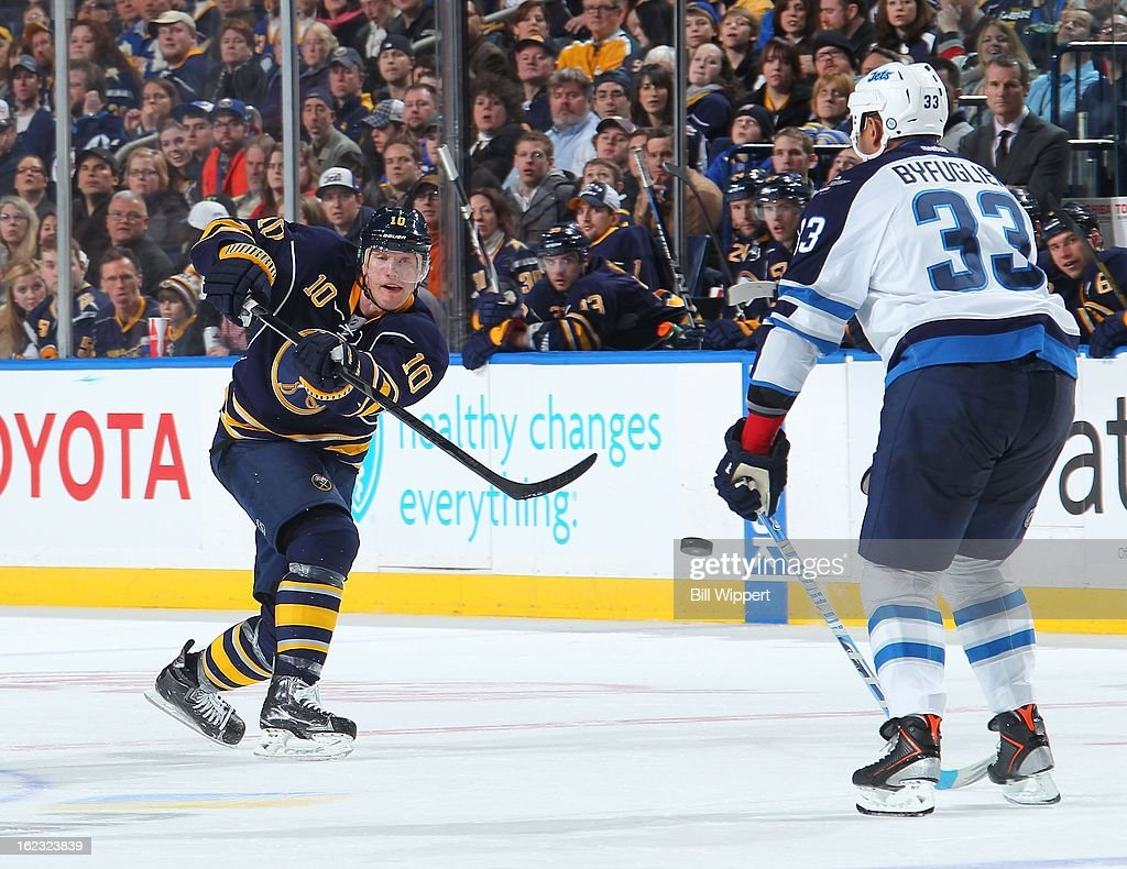 <a gi-track='captionPersonalityLinkClicked' href=/galleries/search?phrase=Christian+Ehrhoff&family=editorial&specificpeople=214788 ng-click='$event.stopPropagation()'>Christian Ehrhoff</a> #10 of the Buffalo Sabres shoots the puck against Dustin Byfuglien #33 of the Winnipeg Jets on February 19, 2013 at the First Niagara Center in Buffalo, New York.