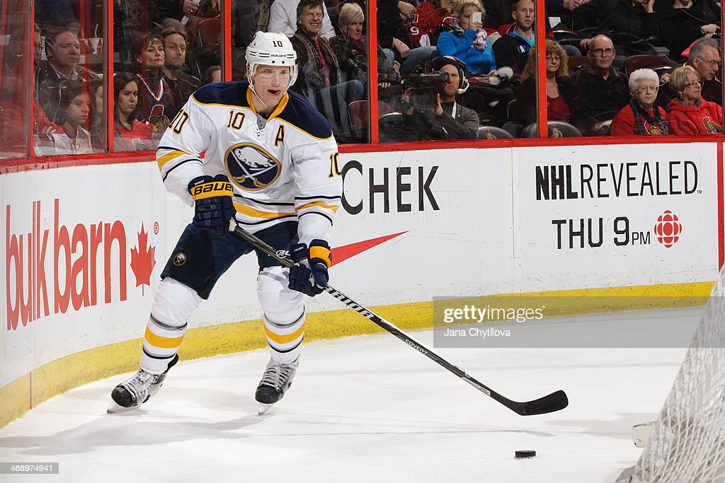 Christian Ehrhoff #10 of the Buffalo Sabres skates with the puck against the Ottawa Senators during an NHL game at Canadian Tire Centre on February 6, 2014 in Ottawa, Ontario, Canada.