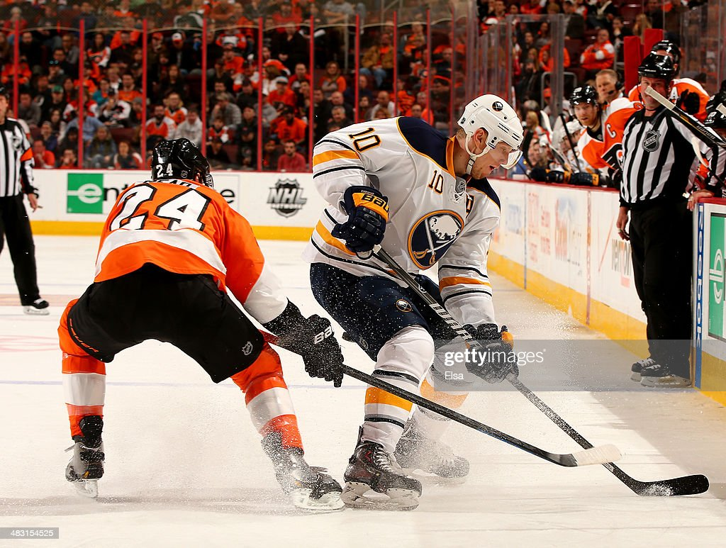 <a gi-track='captionPersonalityLinkClicked' href=/galleries/search?phrase=Christian+Ehrhoff&family=editorial&specificpeople=214788 ng-click='$event.stopPropagation()'>Christian Ehrhoff</a> #10 of the Buffalo Sabres tries to keep the puck from <a gi-track='captionPersonalityLinkClicked' href=/galleries/search?phrase=Matt+Read&family=editorial&specificpeople=6783206 ng-click='$event.stopPropagation()'>Matt Read</a> #24 of the Philadelphia Flyers at Wells Fargo Center on April 6, 2014 in Philadelphia, Pennsylvania.The Philadelphia Flyers defeated the Buffalo Sabres 5-2.