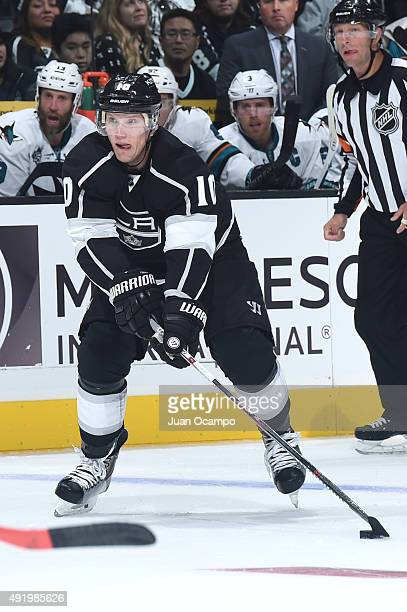 Christian Ehrhoff of the Los Angeles Kings handles the puck during a game against the San Jose Sharks in the NHL season opener at STAPLES Center on...