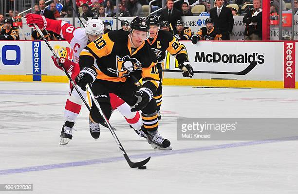 Christian Ehrhoff of the Pittsburgh Penguins skates with the puck against the Detroit Red Wings at Consol Energy Center on March 15 2015 in...