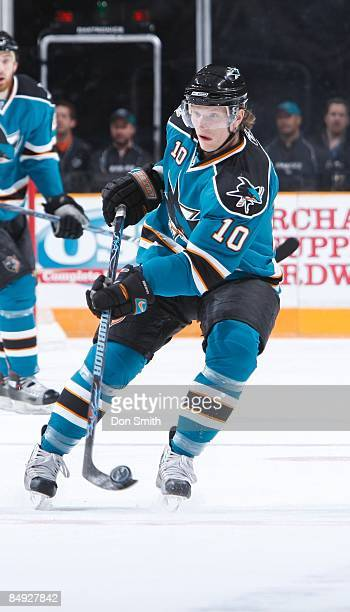 Christian Ehrhoff of the San Jose Sharks flips up the puck during an NHL game against the Edmonton Oilers on February 17 2009 at HP Pavilion at San...