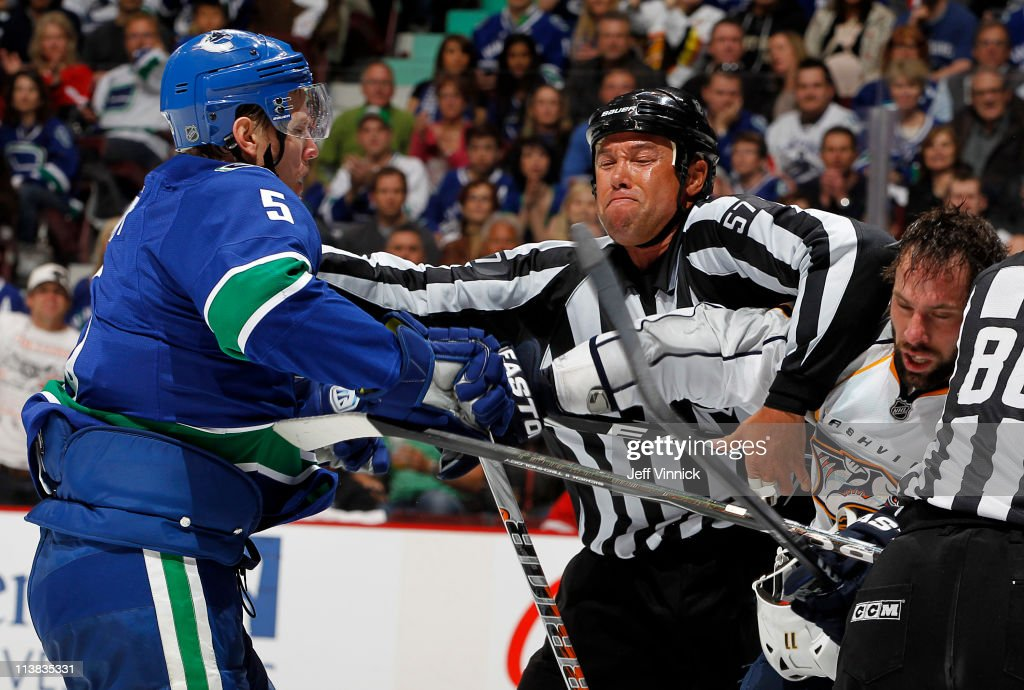 <a gi-track='captionPersonalityLinkClicked' href=/galleries/search?phrase=Christian+Ehrhoff&family=editorial&specificpeople=214788 ng-click='$event.stopPropagation()'>Christian Ehrhoff</a> #5 of the Vancouver Canucks and <a gi-track='captionPersonalityLinkClicked' href=/galleries/search?phrase=David+Legwand&family=editorial&specificpeople=202553 ng-click='$event.stopPropagation()'>David Legwand</a> #11 of the Nashville Predators scrap during Game Five of the Western Conference Semifinal of the 2011 NHL Stanley Cup playoffs at Rogers Arena on May 7, 2011 in Vancouver, British Columbia, Canada.