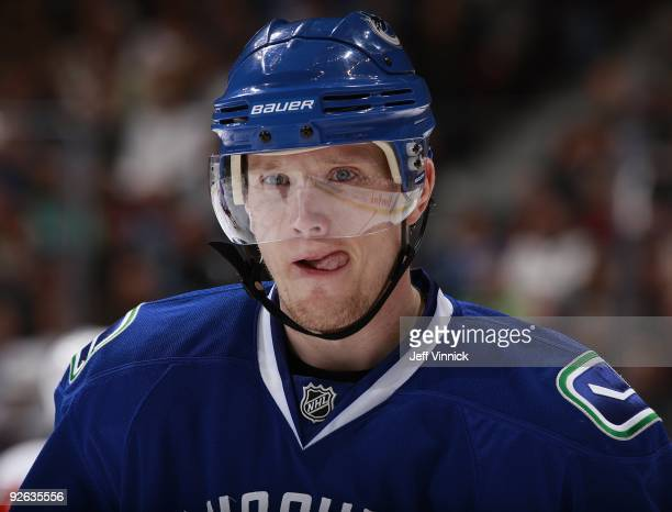 Christian Ehrhoff of the Vancouver Canucks looks on from the bench during their game against the Detroit Red Wings at General Motors Place on October...