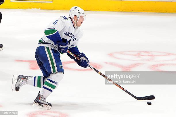 Christian Ehrhoff of the Vancouver Canucks skates with the puck against the Los Angeles Kings in Game Three of the Western Conference Quarterfinals...