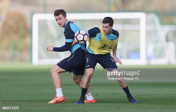Christian Eriksen and Harry Winks of Tottenham during the Tottenham Hotspur training session at Tottenham Hotspur Training Centre on March 9 2017 in...