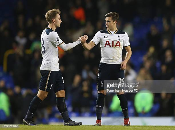 Christian Eriksen and Harry Winks of Tottenham Hotspur celebrate their win after the Premier League match between Tottenham Hotspur and Hull City at...