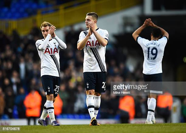 Christian Eriksen and Kevin Wimmer of Tottenham Hotspur applaud the crowd after the Barclays Premier League match between Tottenham Hotspur and AFC...
