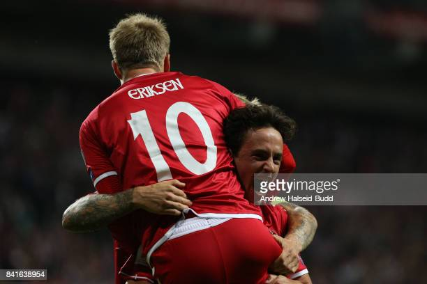 Christian Eriksen celebrates with Thomas delaney after Delaney scored the first goal for Denmark during the FIFA 2018 World Cup Qualifier between...