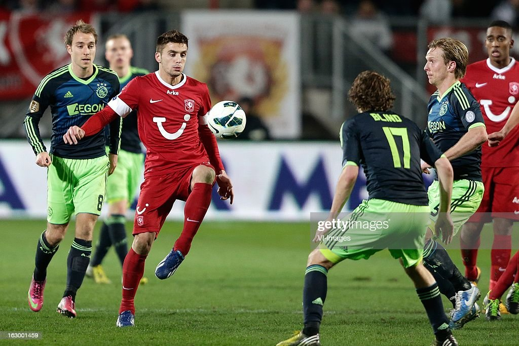 Christian Eriksen (R) Christian Poulsen (R) of Ajax Dusan Tadic of FC Twente (C) during the Dutch Eredivisie match between FC Twente and Ajax Amsterdam at the Grolsch Veste on march 02, 2013 in Enschede, The Netherlands