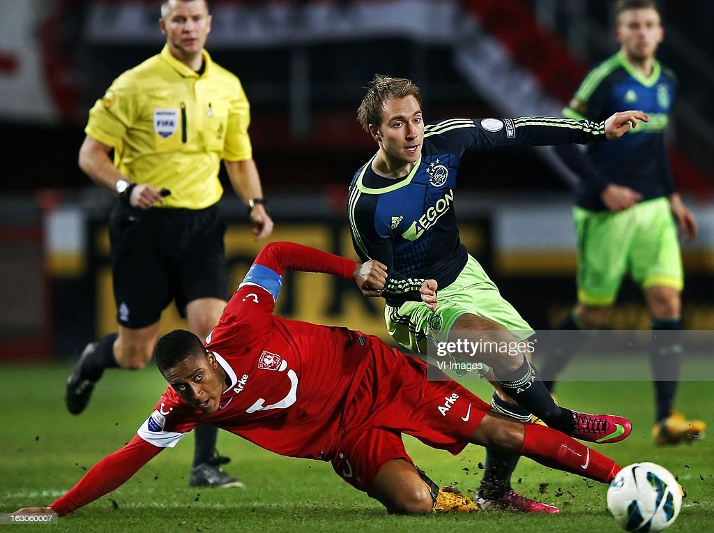 Christian Eriksen (R), Leroy Fer (L) during the Dutch Eredivisie match between FC Twente and Ajax Amsterdam at the Grolsch Veste on march 02, 2013 in Enschede, The Netherlands