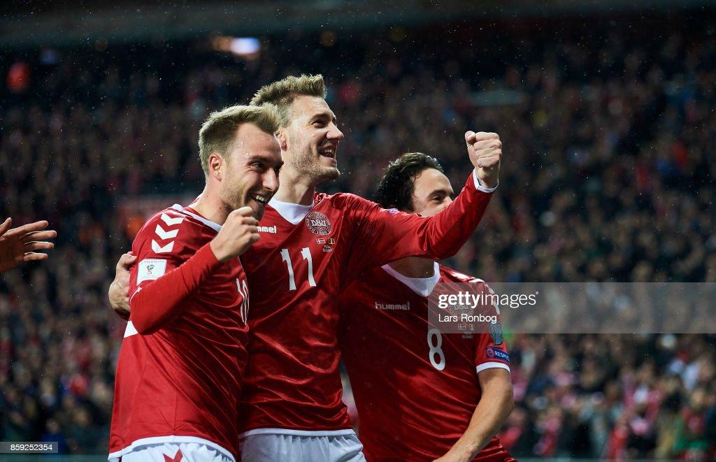 Christian Eriksen, Nicklas Bendtner and Thomas Delaney of Denmark celebrate after scoring their first goal during the FIFA World Cup 2018 qualifier match between Denmark and Romania at Telia Parken Stadium on October 8, 2017 in Copenhagen, Denmark.