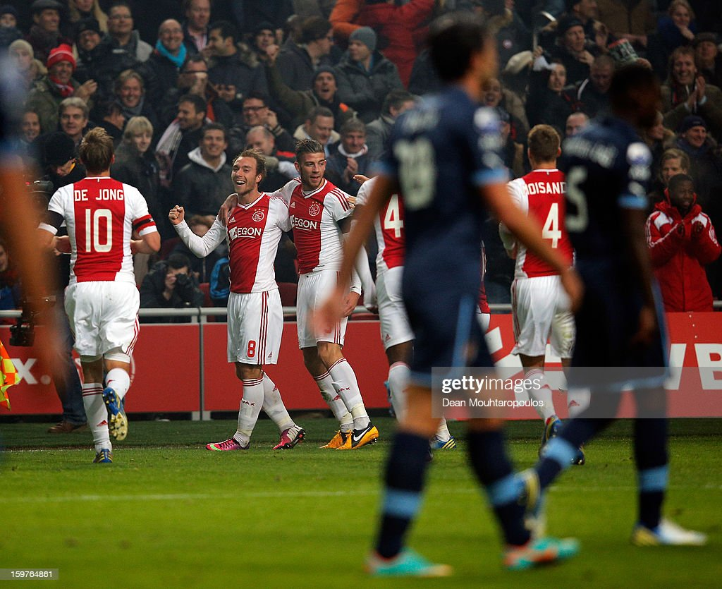 <a gi-track='captionPersonalityLinkClicked' href=/galleries/search?phrase=Christian+Eriksen&family=editorial&specificpeople=6757192 ng-click='$event.stopPropagation()'>Christian Eriksen</a> (#8) of Ajax is congratulated by team mates after he scores the third goal of the game during the Eredivisie match between Ajax Amsterdam and Feyenoord Rotterdam at Amsterdam Arena on January 20, 2013 in Amsterdam, Netherlands.