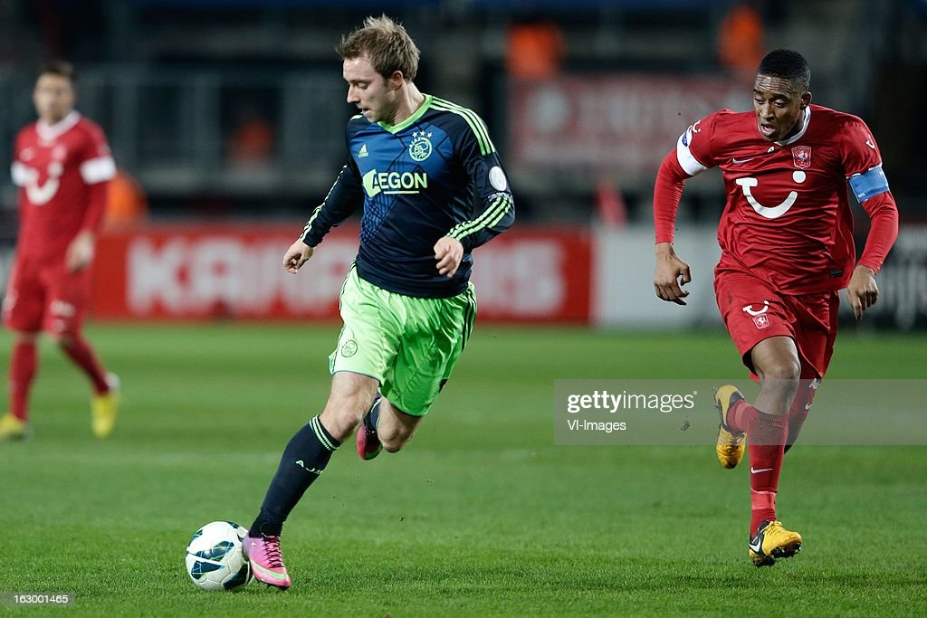 Christian Eriksen of Ajax (L) Leroy Fer of FC Twente (R) during the Dutch Eredivisie match between FC Twente and Ajax Amsterdam at the Grolsch Veste on march 02, 2013 in Enschede, The Netherlands