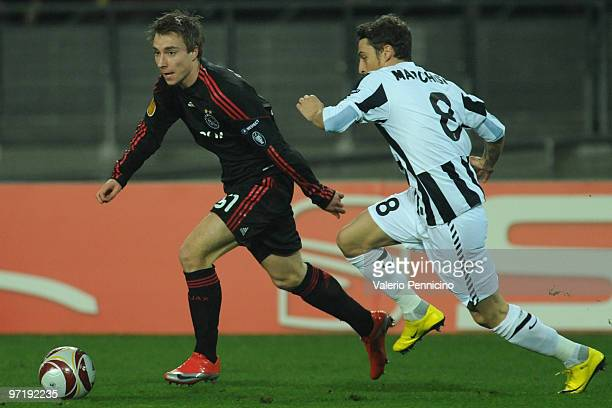 Christian Eriksen of Ajax run off Claudio Marchisio of Juventus during the UEFA Europa League Round 32 second leg match between Juventus and Ajax on...