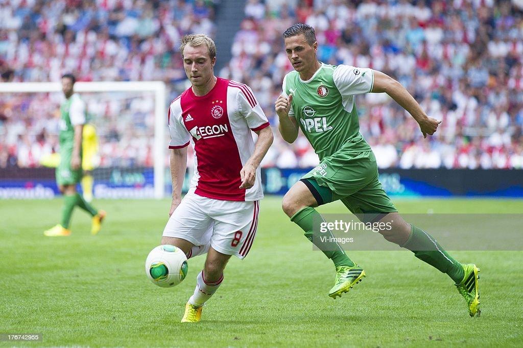 Christian Eriksen of Ajax, Wesley Verhoek of Feyenoord during the Dutch Eredivisie match between Ajax Amsterdam and Feyenoord on August 18, 2013 at the Amsterdam Arena in Amsterdam, The Netherlands.