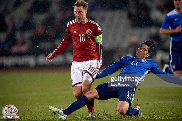 Christian Eriksen of Denmark and Alejandro Bedoya of United States compete for the ball during the International Friendly match between Denmark and...