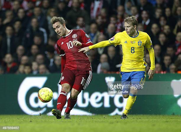 Christian Eriksen of Denmark and Oscar Lewicki of Sweden in action during the UEFA EURO 2016 qualifier playoff second leg match between Denmark and...