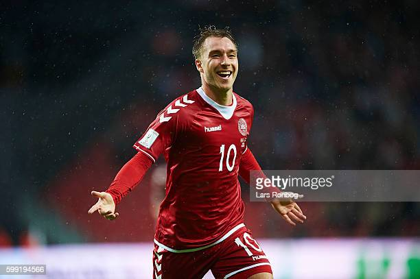 Christian Eriksen of Denmark celebrates after scoring their first goal during the FIFA World Cup 2018 european qualifier match between Denmark and...
