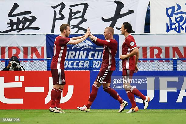 Christian Eriksen of Denmark celebrates scoring his team's second goal with his team mates Viktor Fischer and Thomas Delaney during the international...