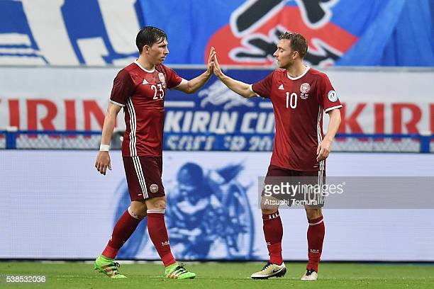 Christian Eriksen of Denmark celebrates scoring his team's third goal with his team mate PierreEmile Hojbjerg during the international friendly match...