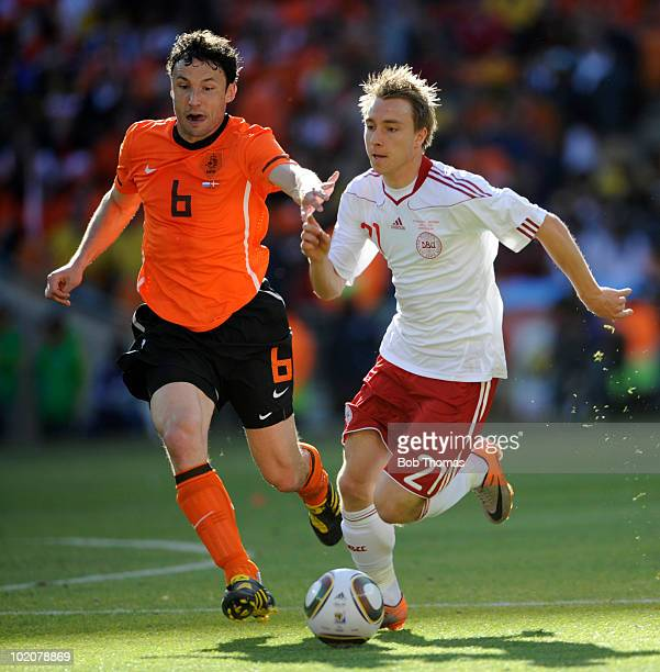 Christian Eriksen of Denmark chased by Mark Van Bommel of the Netherlands during the 2010 FIFA World Cup Group E match between Netherlands and...