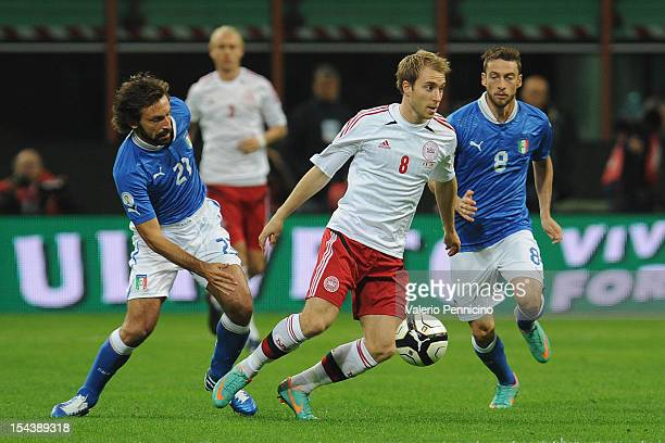 Christian Eriksen of Denmark in action against Andrea Pirlo of Italy during the FIFA 2014 World Cup qualifier match between Italy and Denmark at...
