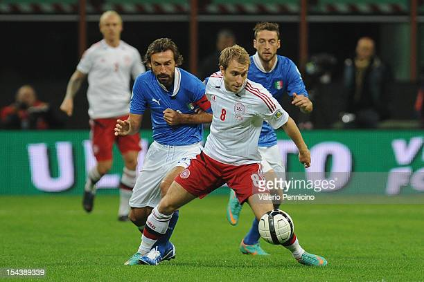 Christian Eriksen of Denmark is challenged by Andrea Pirlo of Italy during the FIFA 2014 World Cup qualifier match between Italy and Denmark at...